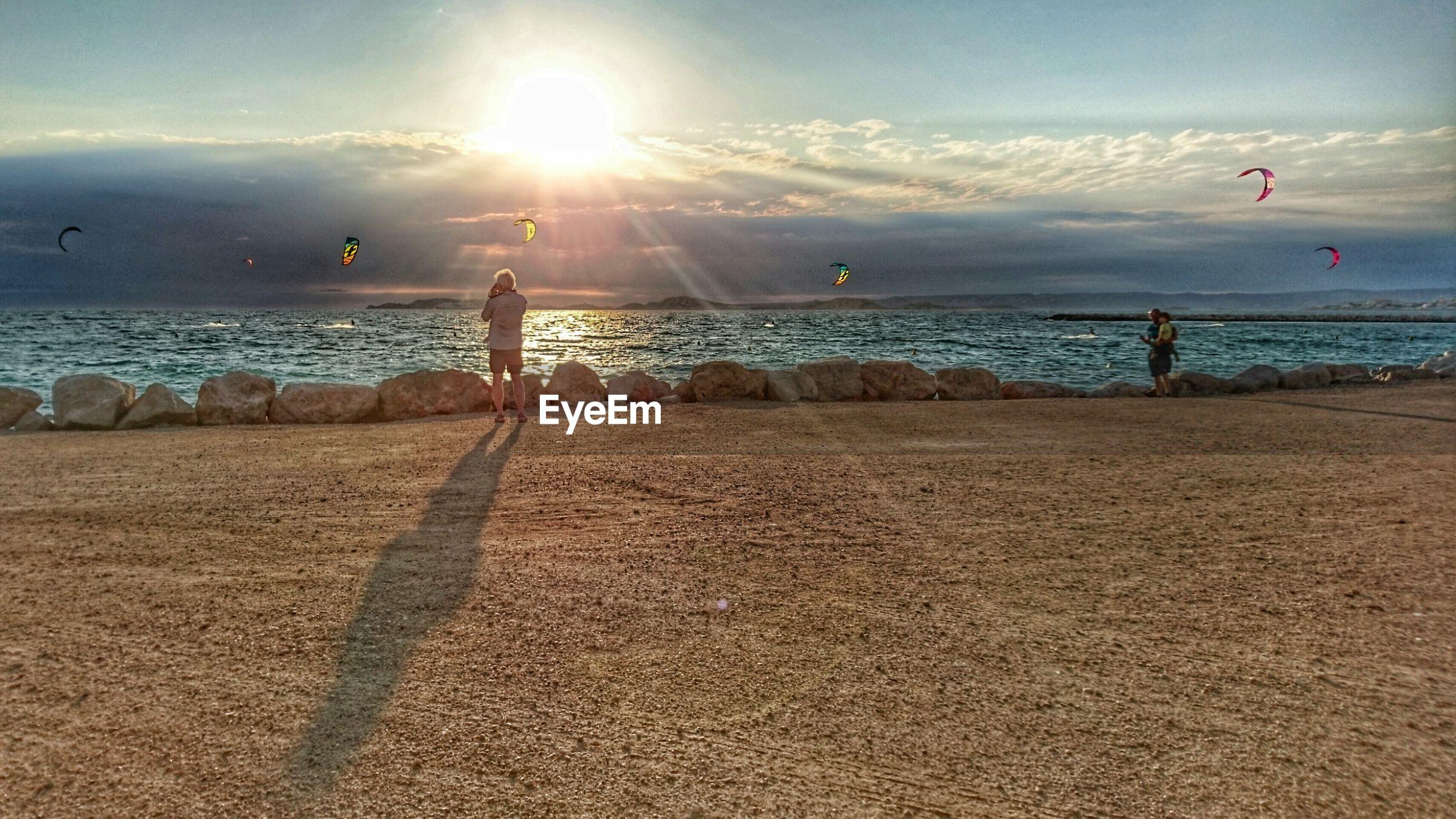 People standing on promenade against sea