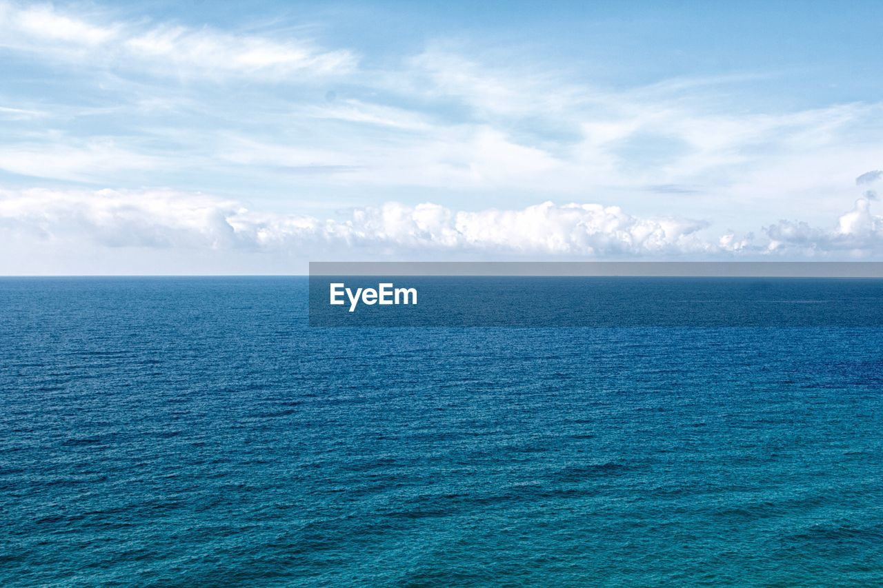 sea, horizon over water, water, tranquil scene, scenics, tranquility, beauty in nature, nature, sky, idyllic, cloud - sky, rippled, no people, blue, outdoors, remote, waterfront, day