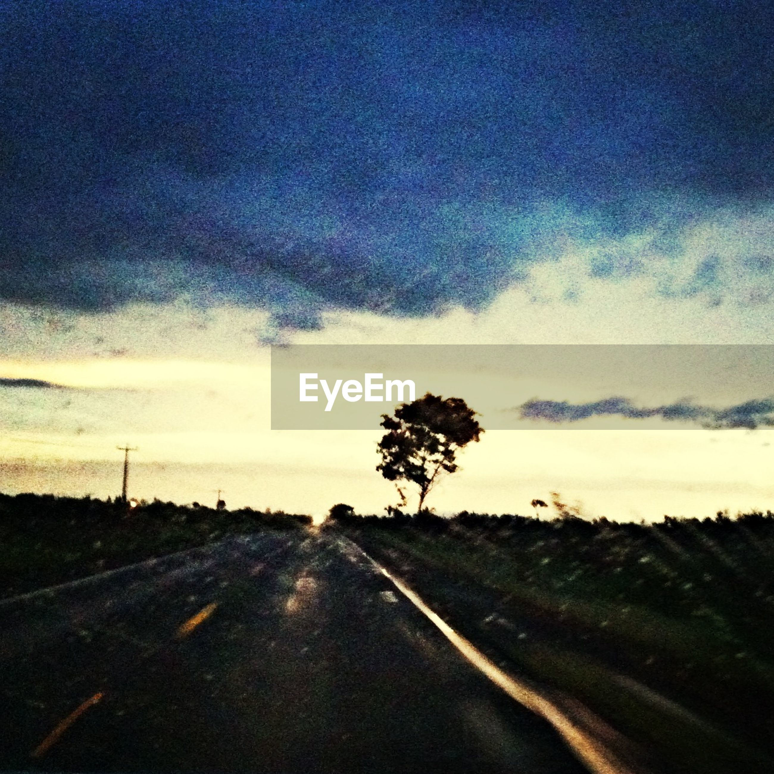 the way forward, sky, road, tranquility, tranquil scene, landscape, diminishing perspective, country road, transportation, tree, vanishing point, cloud - sky, scenics, nature, beauty in nature, empty road, field, cloud, cloudy, road marking