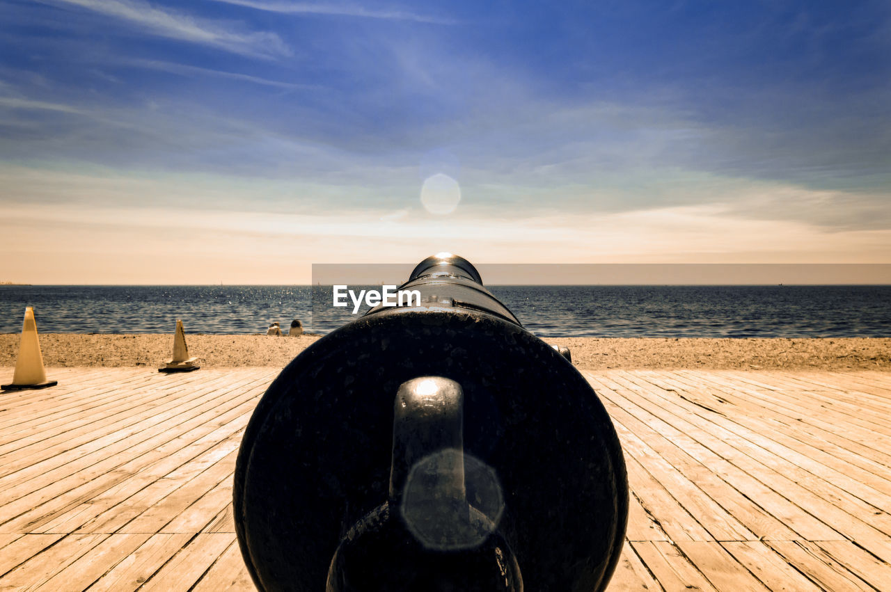 Close-Up Of Cannon On Wooden Floor At Beach