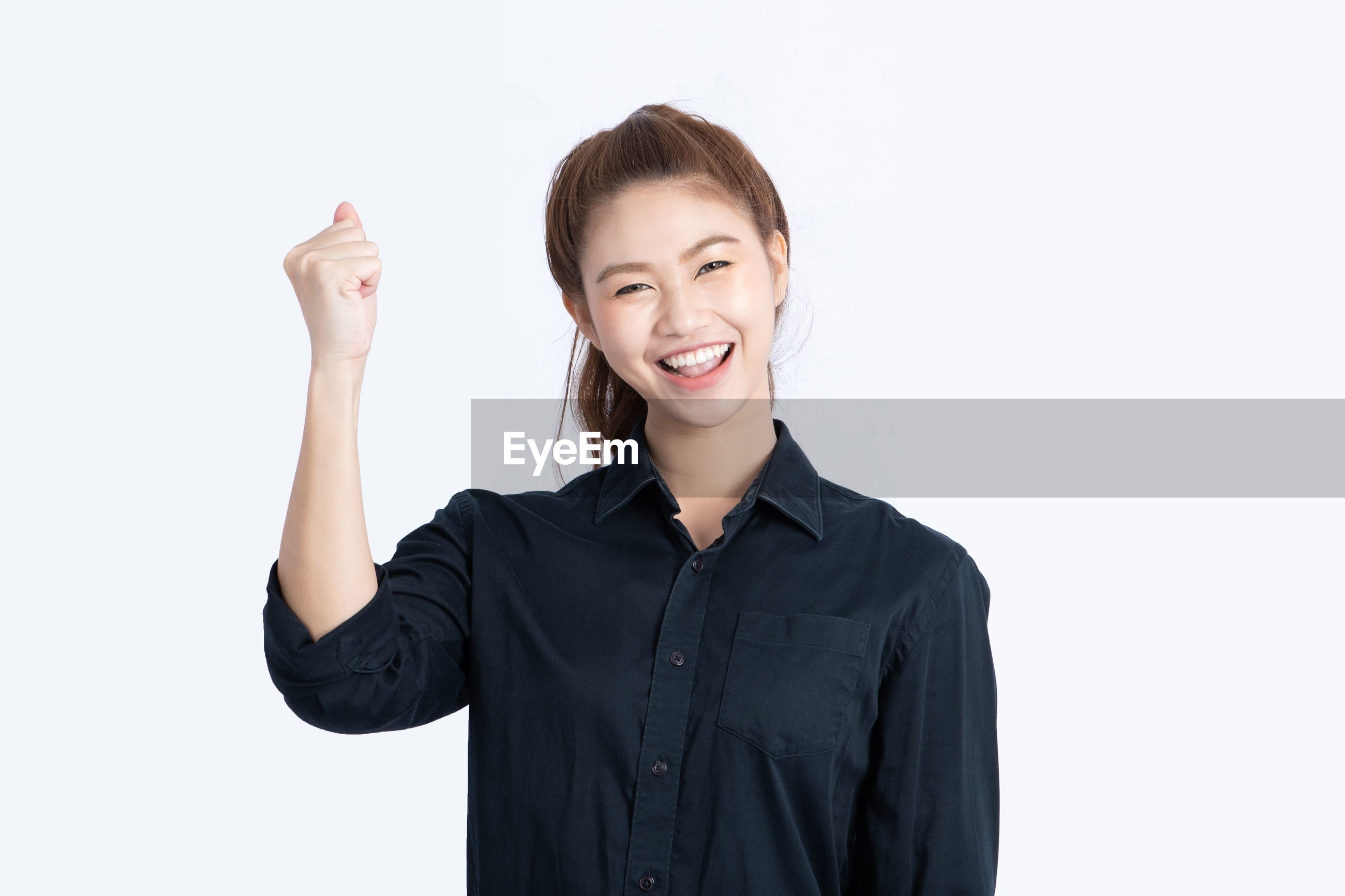 Portrait of happy woman standing against white background