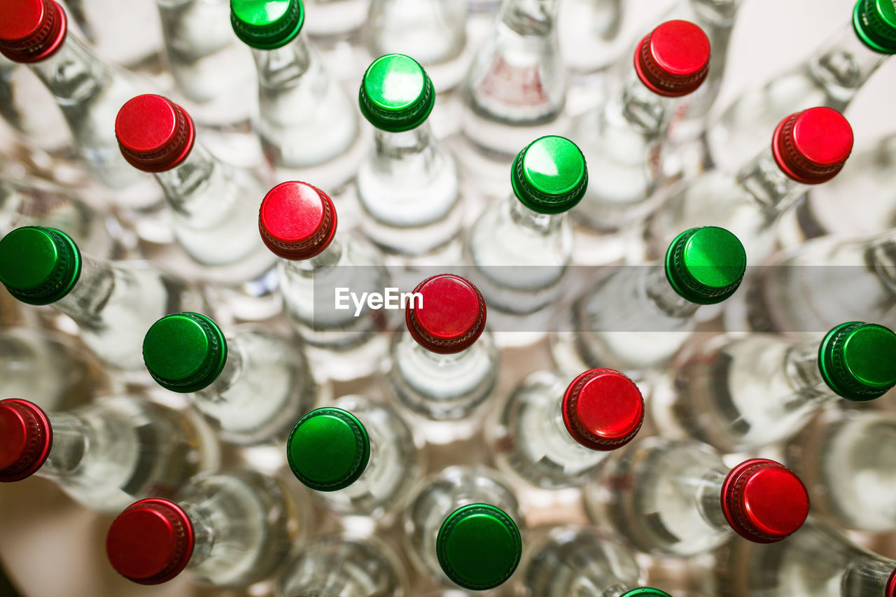 Directly above shot of multi colored bottles on table