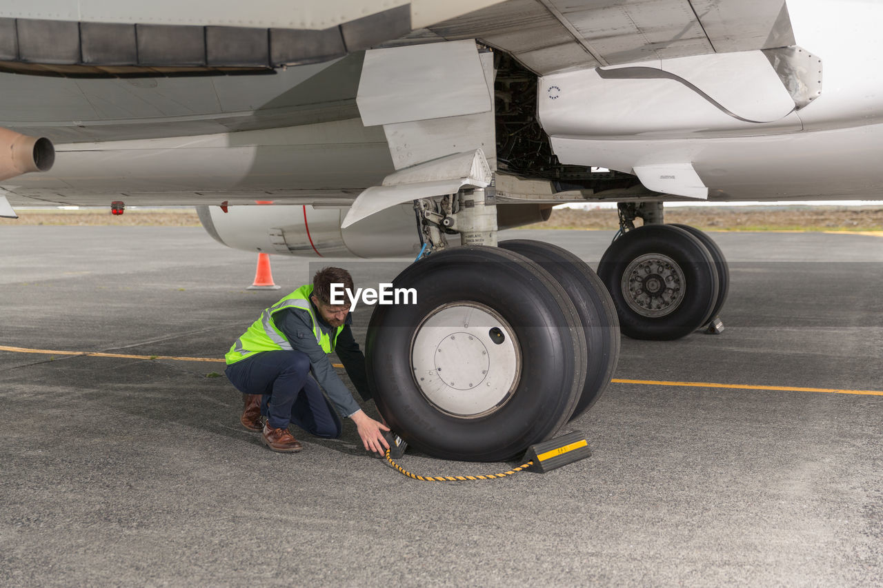 MAN WORKING AT AIRPORT
