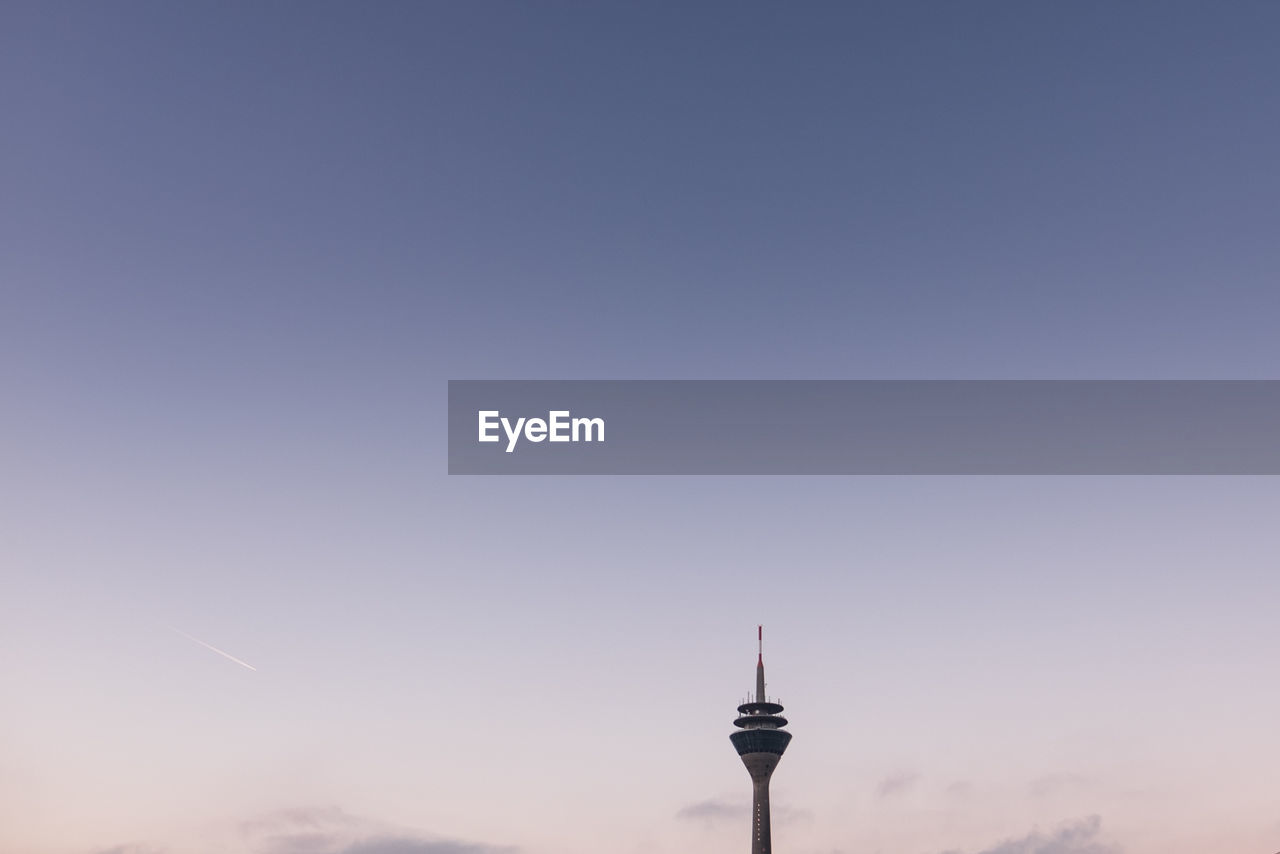 Low Angle View Of Rheinturm Tower Against Sky During Sunset