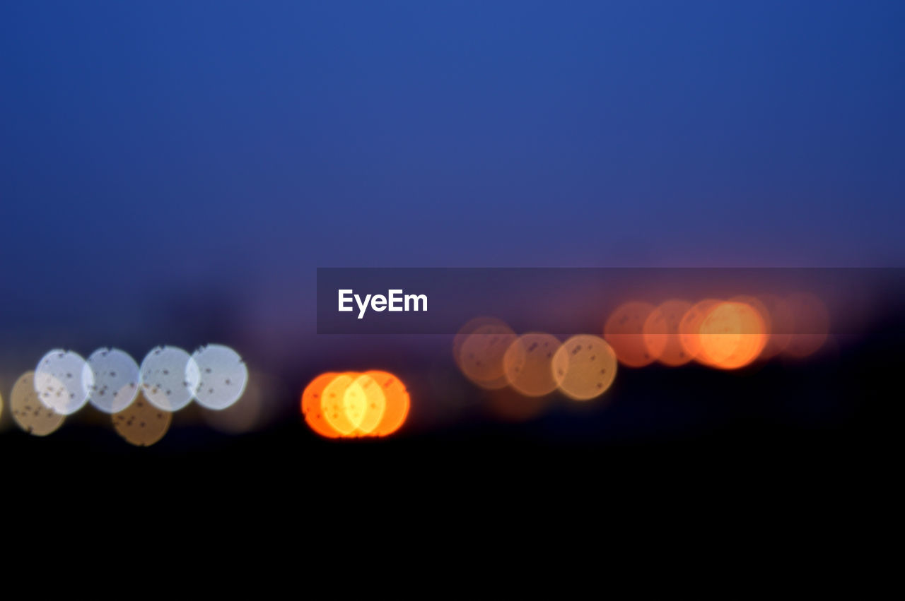 defocused, night, glowing, illuminated, no people, sunset, beauty in nature, sky, outdoors, nature, scenics, close-up