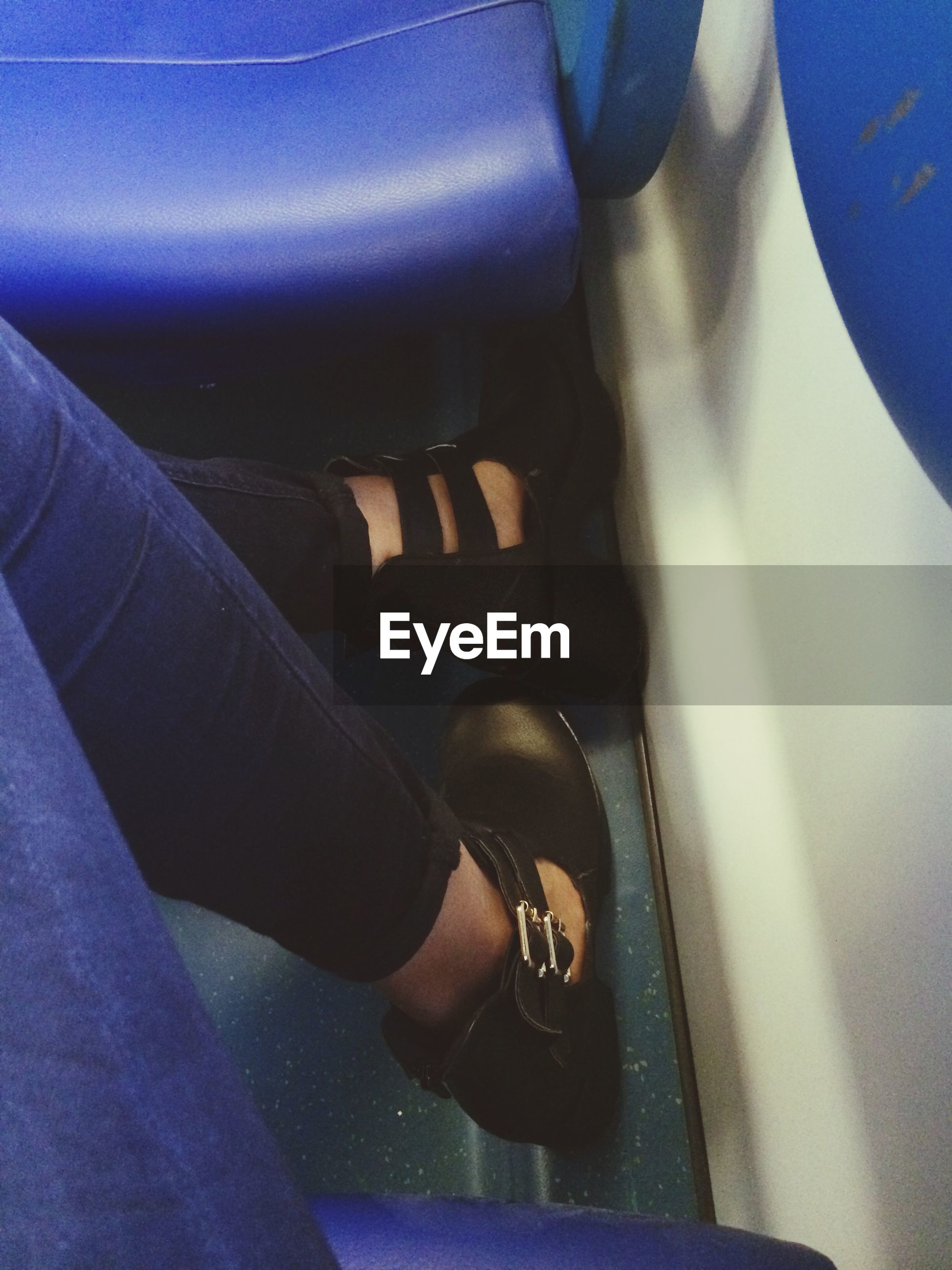 part of, person, low section, indoors, lifestyles, personal perspective, men, cropped, unrecognizable person, leisure activity, human foot, close-up, shoe, blue, transportation, high angle view