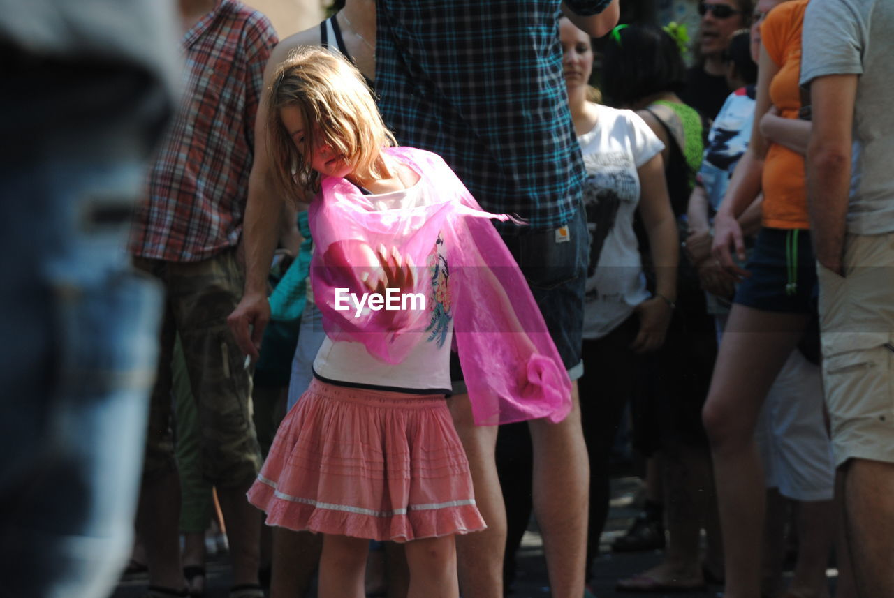 pink color, real people, rear view, standing, celebration, outdoors, women, togetherness, day, girls, men, large group of people, people