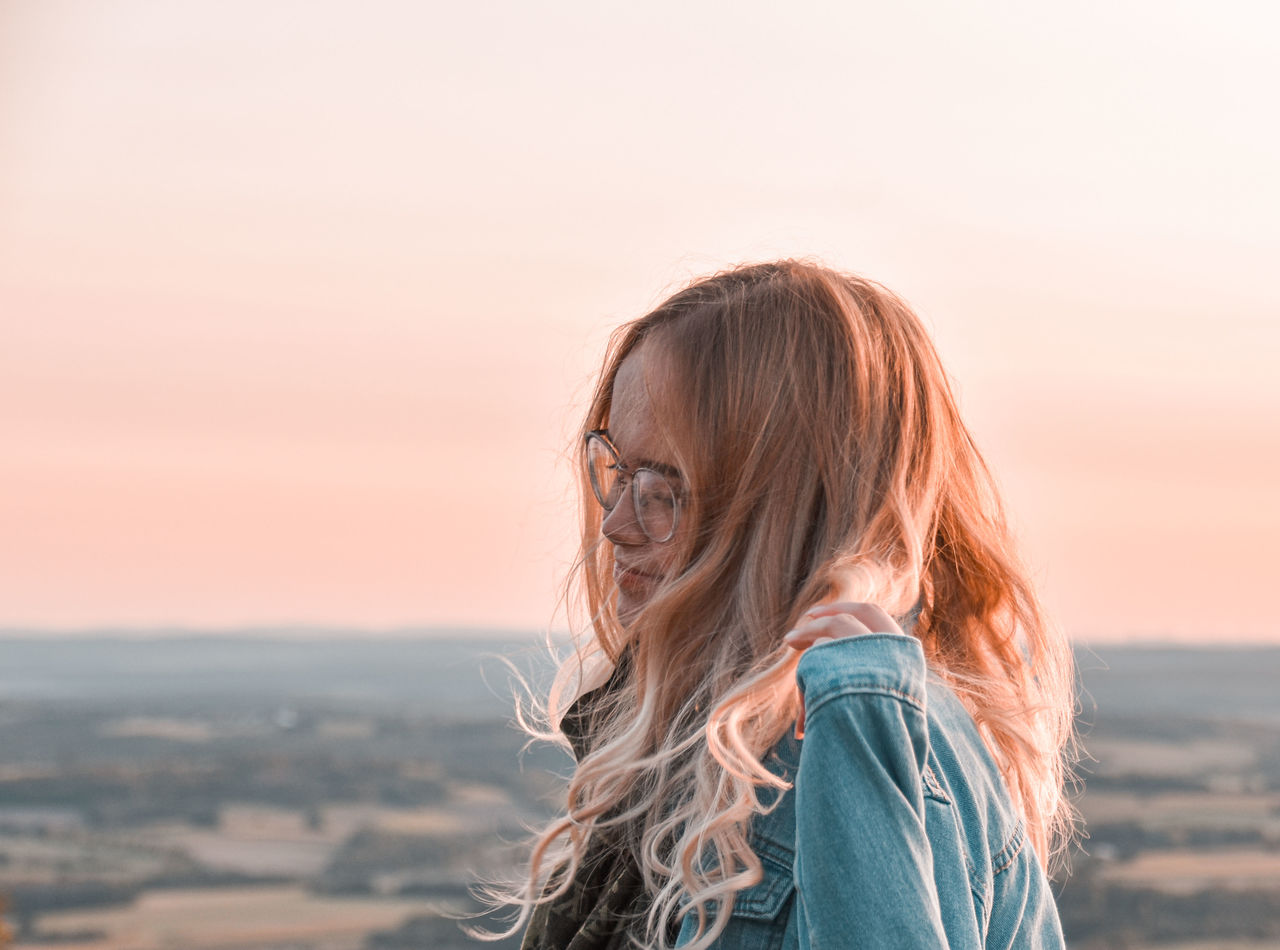 Portrait of woman against sky during sunset