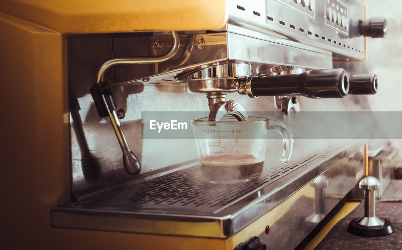 CLOSE-UP OF COFFEE SERVED IN KITCHEN