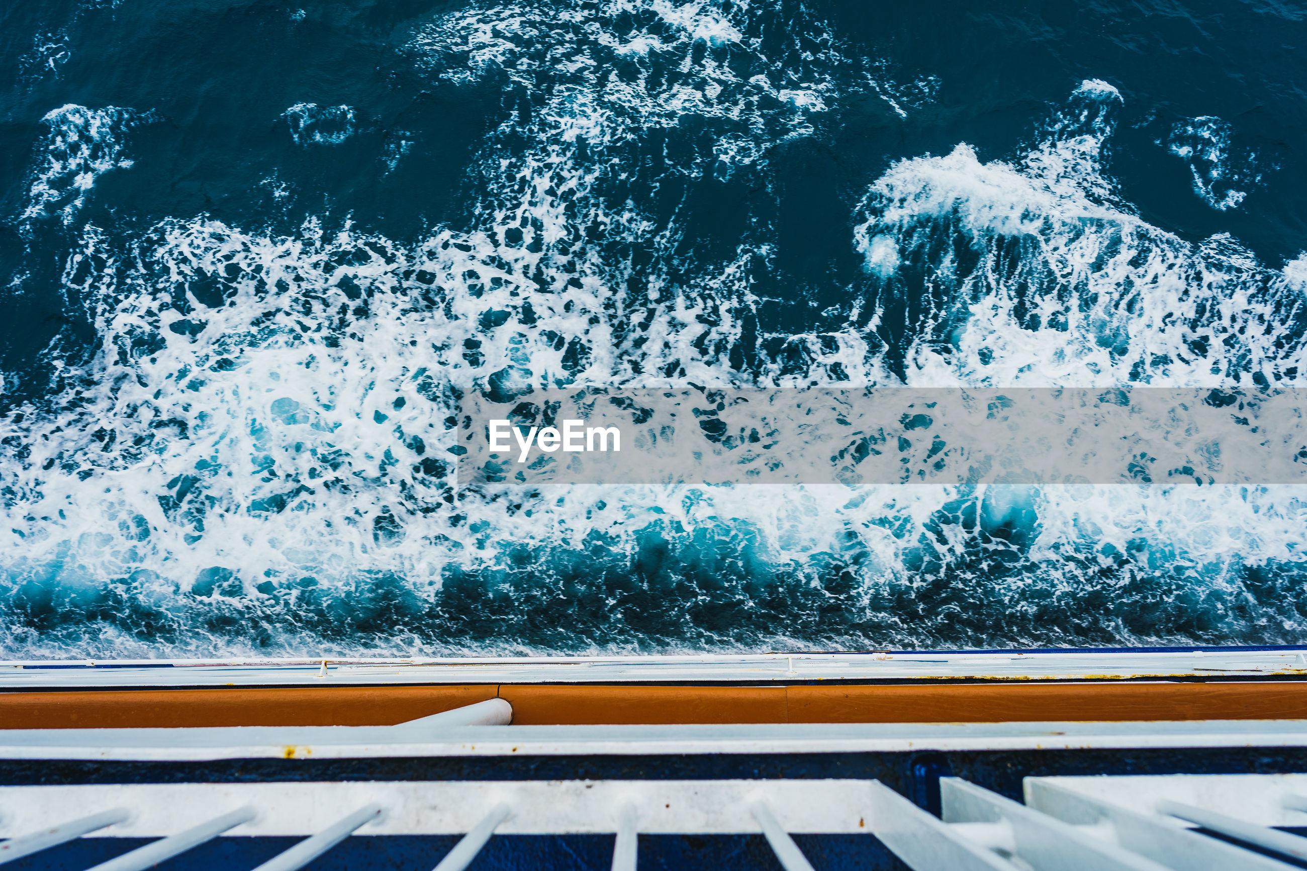 HIGH ANGLE VIEW OF SWIMMING POOL AT SEA