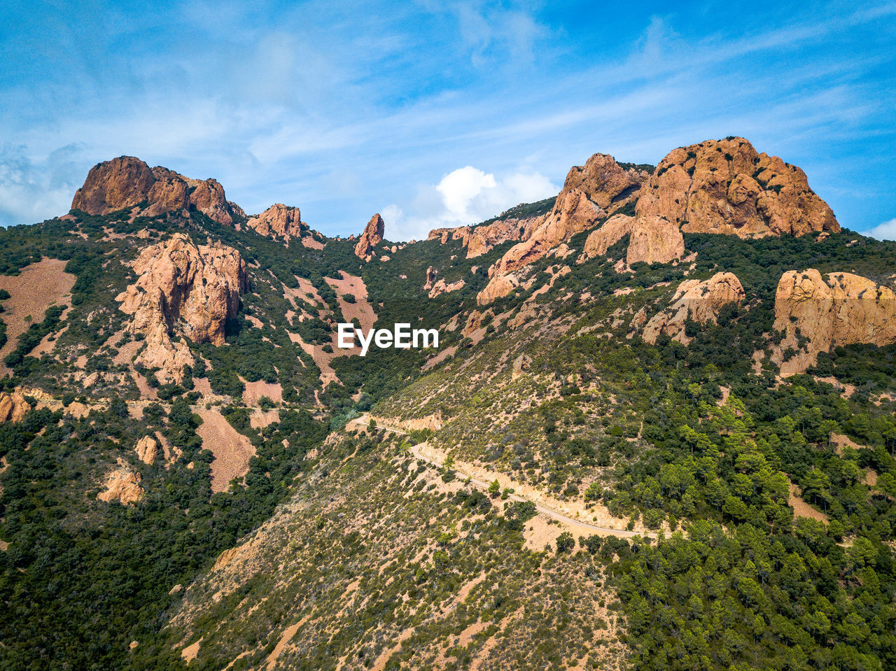 beauty in nature, sky, tranquil scene, mountain, scenics - nature, tranquility, cloud - sky, environment, nature, non-urban scene, rock, landscape, day, no people, mountain range, idyllic, rock formation, land, rock - object, physical geography, outdoors, formation, mountain peak, eroded, arid climate