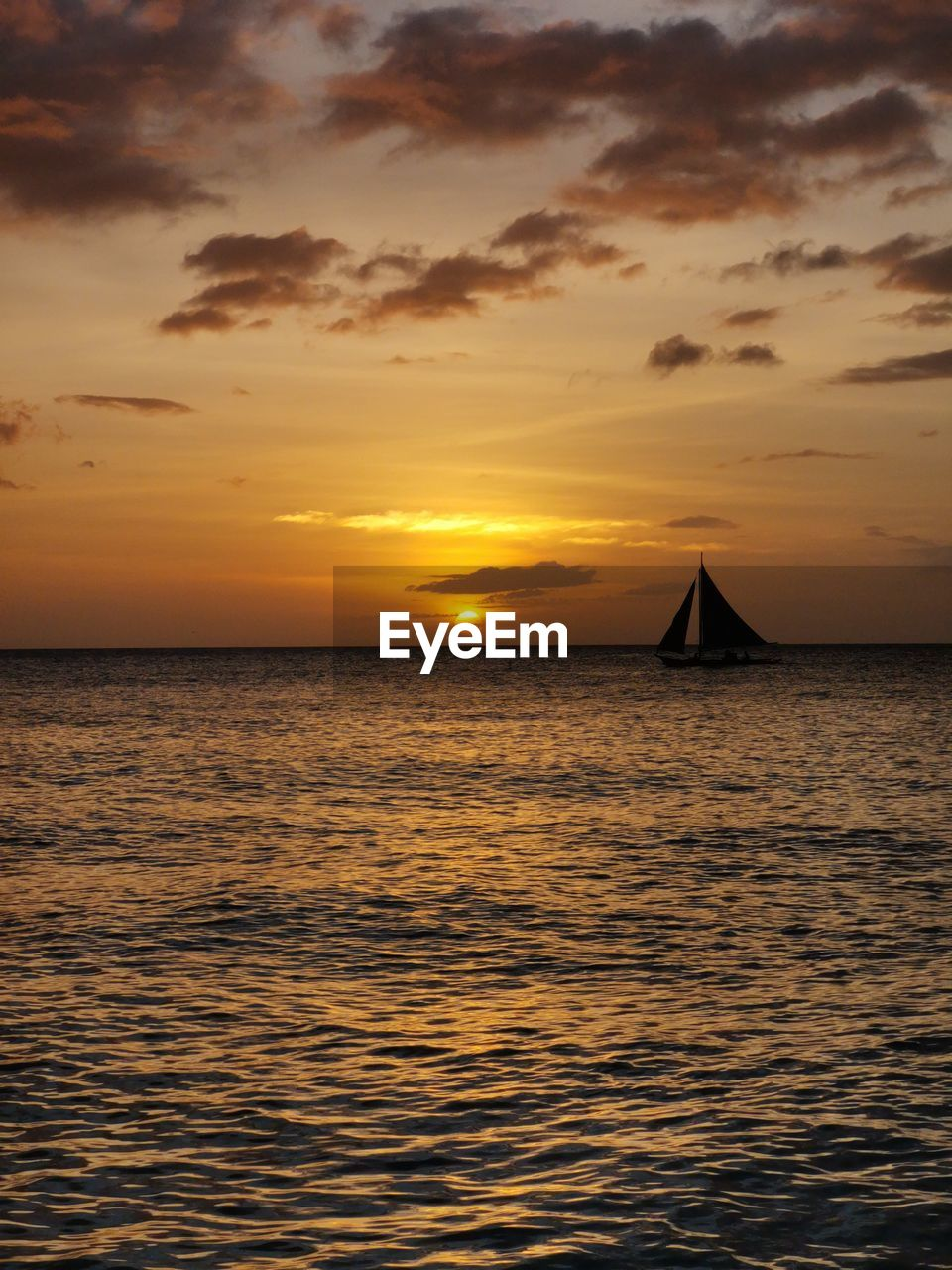 sky, sunset, water, sea, beauty in nature, scenics - nature, cloud - sky, waterfront, tranquil scene, tranquility, orange color, horizon, nature, horizon over water, idyllic, no people, transportation, sun, nautical vessel, sailboat, outdoors
