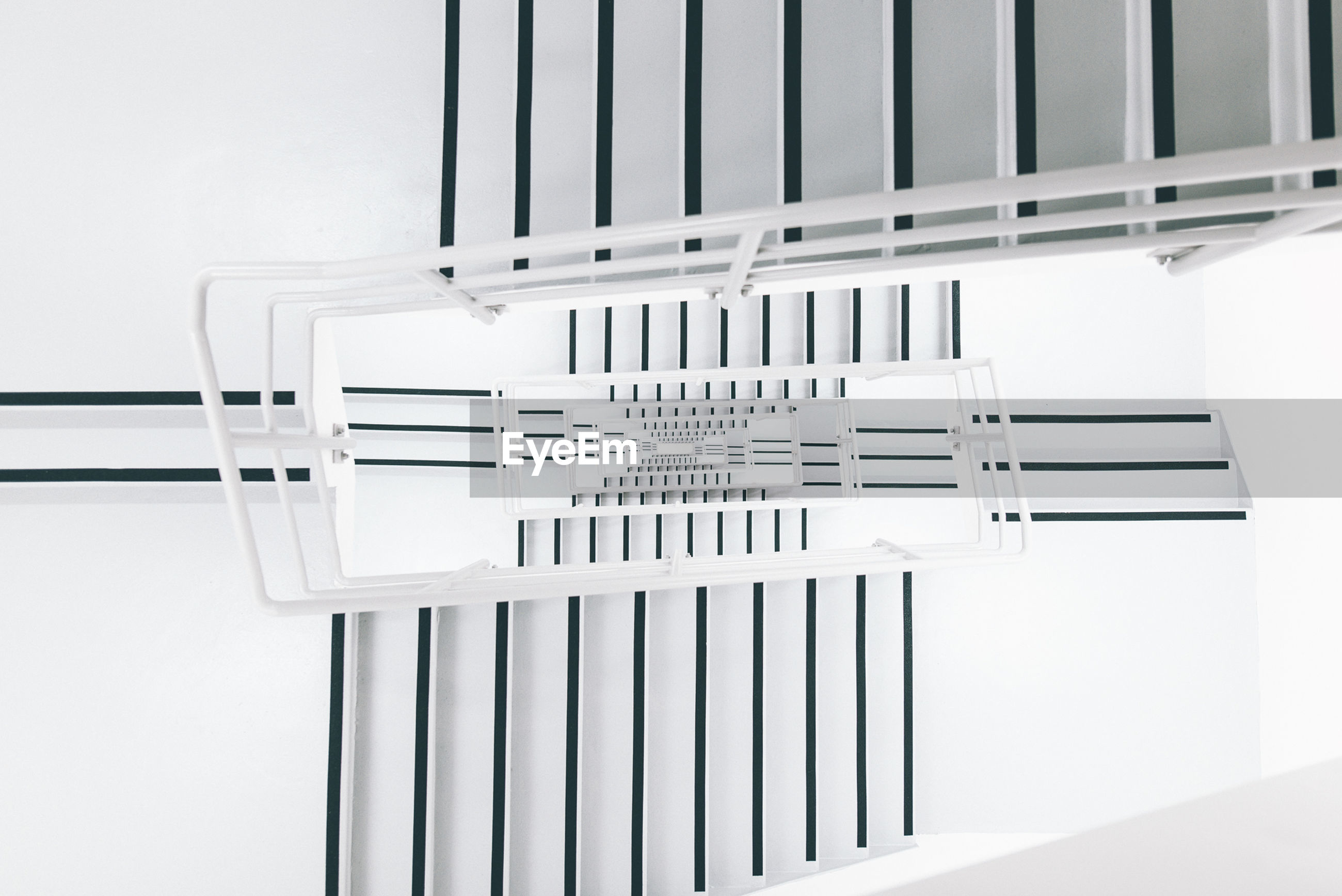 Directly below shot of staircases in modern building