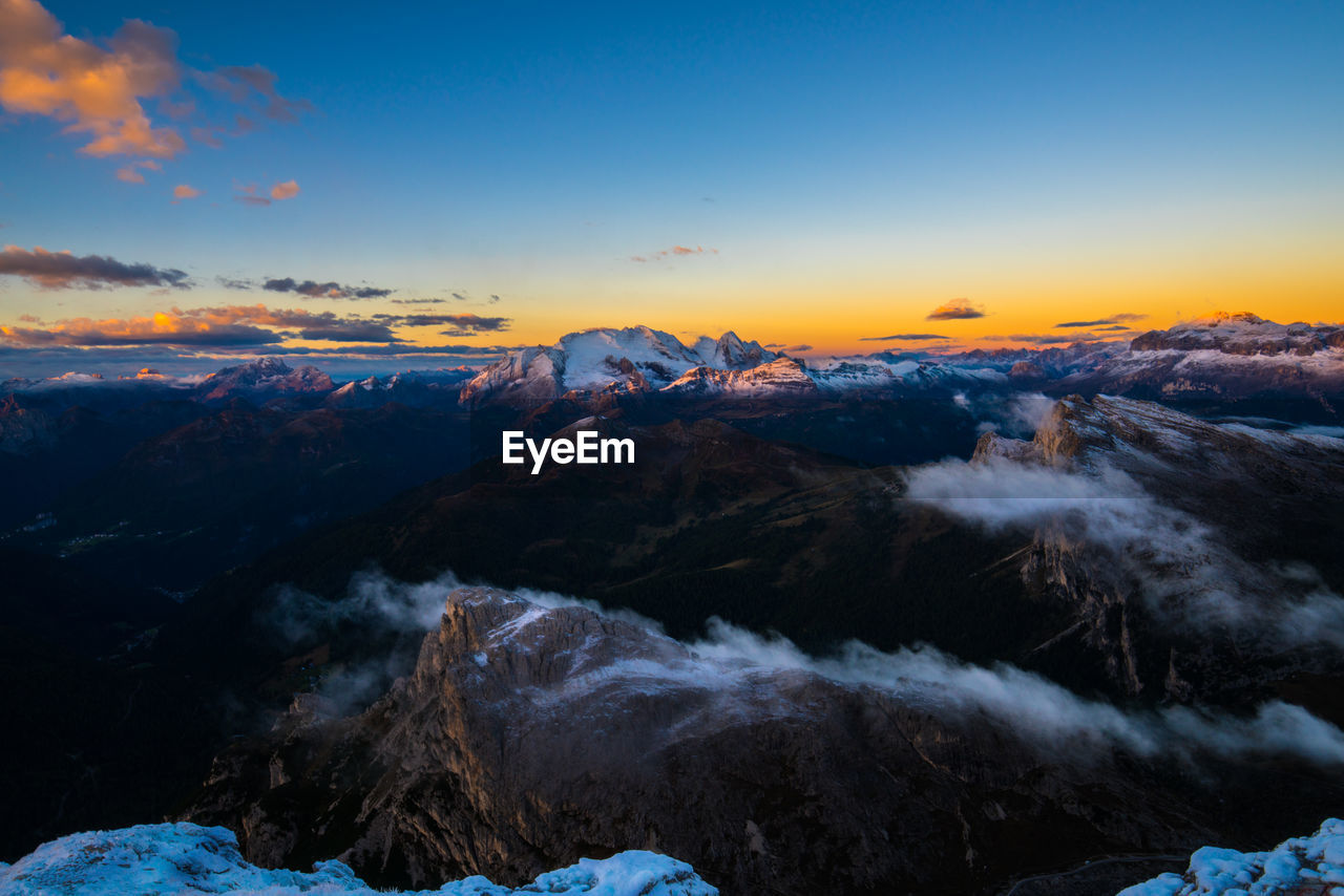 Idyllic shot of snow covered mountains against sky during sunset