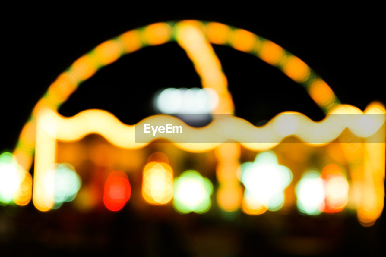 night, illuminated, defocused, glowing, no people, outdoors, close-up, multi colored, city, sky