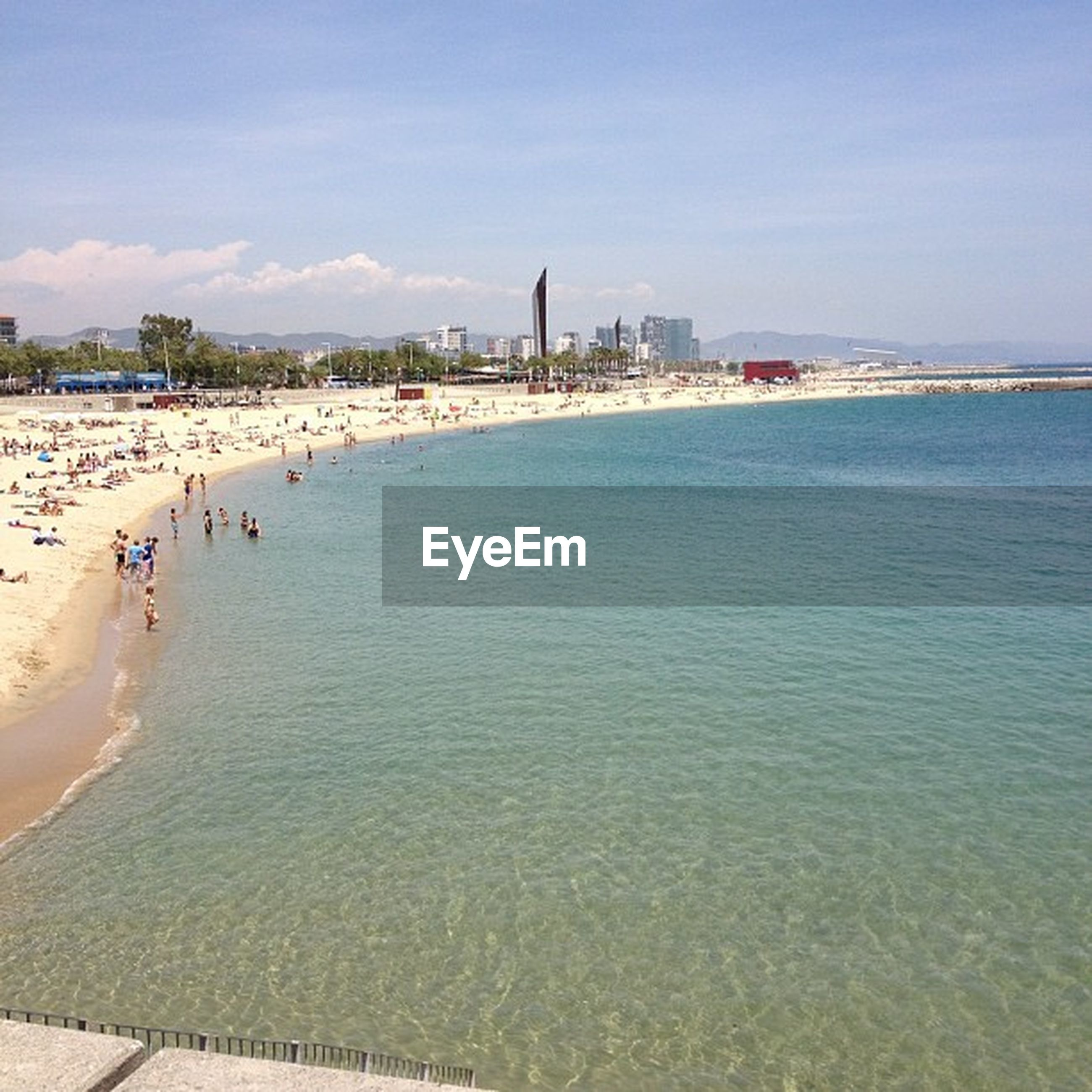 water, sea, built structure, building exterior, architecture, beach, sky, large group of people, shore, tourism, incidental people, city, vacations, travel destinations, leisure activity, tourist, travel, lifestyles, sand