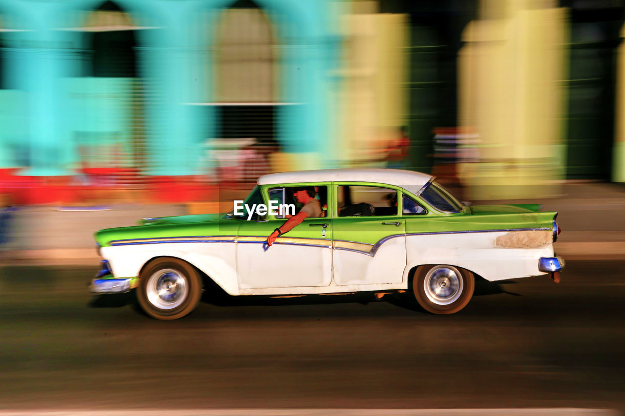 transportation, speed, blurred motion, mode of transport, car, land vehicle, motion, no people, road, day, outdoors, close-up