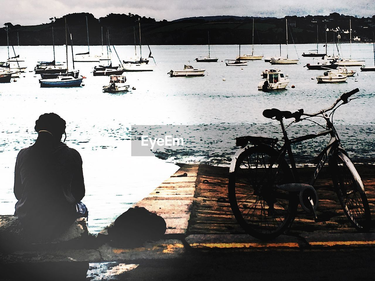 water, transportation, nautical vessel, mode of transportation, sea, nature, day, real people, one person, men, lifestyles, moored, sunlight, beauty in nature, sitting, bicycle, rear view, outdoors, looking at view
