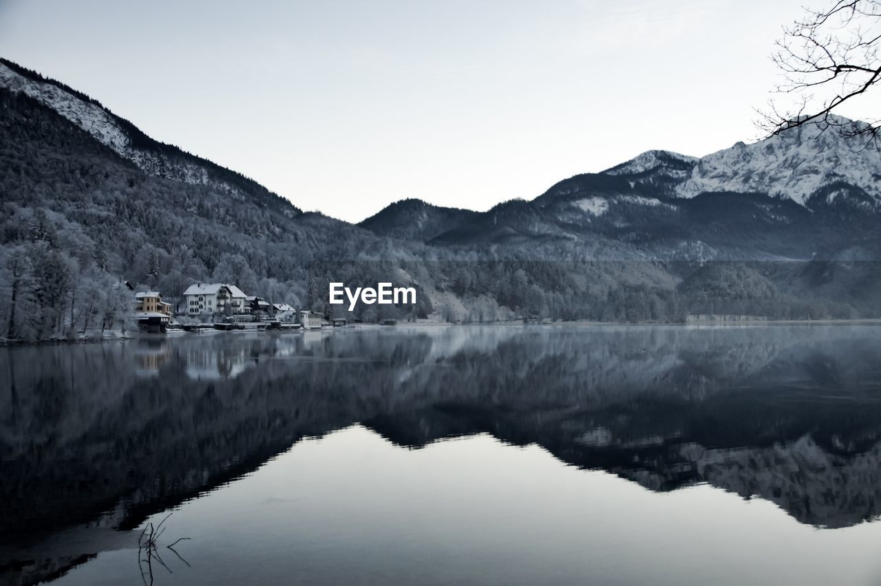 Reflection Of Mountains In Lake Against Sky