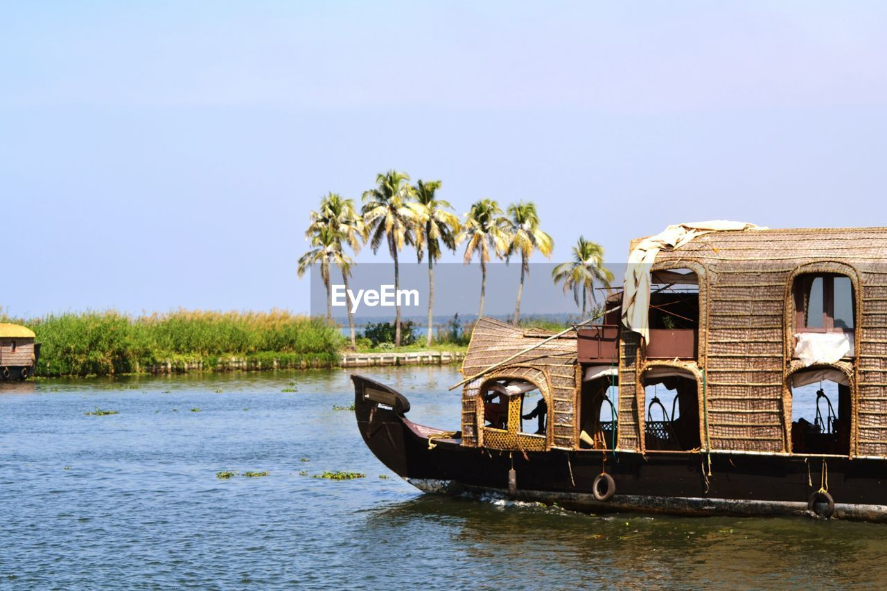 Houseboat In River Against Clear Sky At Alappuzha