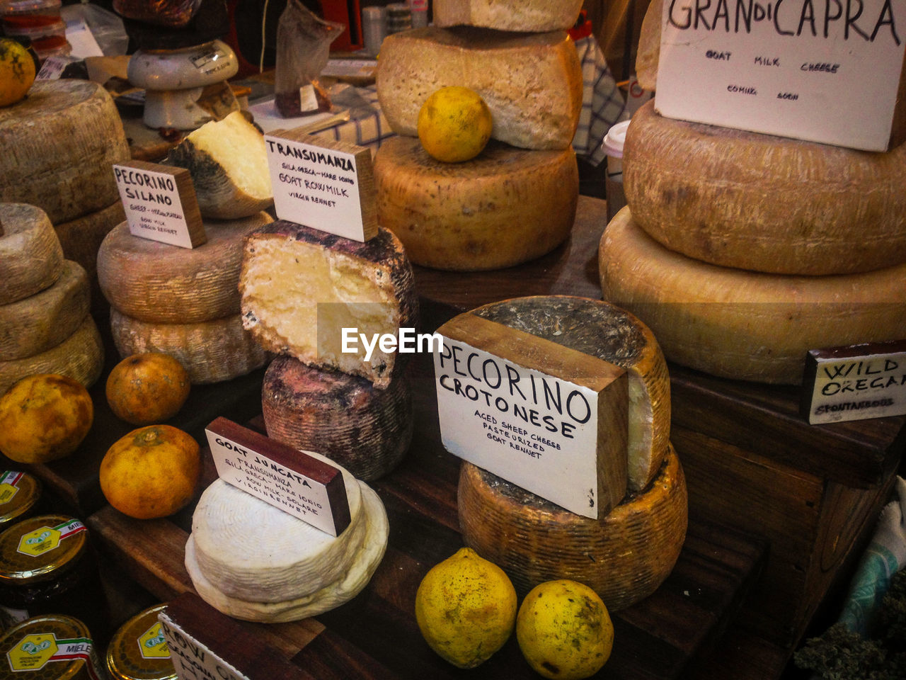 Various Cheese For Sale On Table At Market