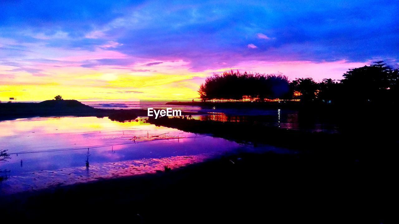 sky, sunset, cloud - sky, water, nature, beauty in nature, scenics - nature, silhouette, reflection, pink color, orange color, tranquility, no people, tranquil scene, outdoors, lake, dramatic sky, plant, dusk, purple, romantic sky