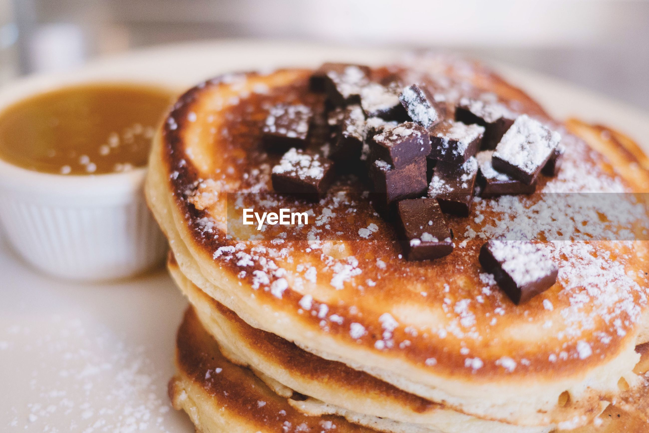 Close-up of chocolate chips on pancakes in plate