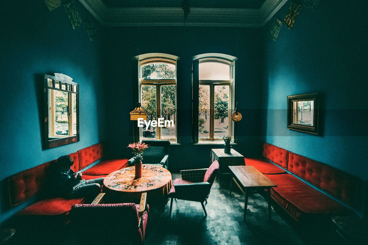 seat, indoors, window, absence, table, chair, no people, empty, architecture, day, furniture, built structure, business, restaurant, building, wall - building feature, domestic room, arch, setting