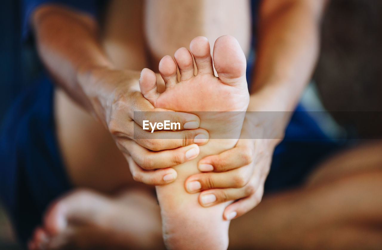 human body part, human hand, hand, body part, real people, togetherness, human leg, close-up, people, child, two people, human foot, bonding, selective focus, focus on foreground, finger, adult, indoors, human finger, women, human limb