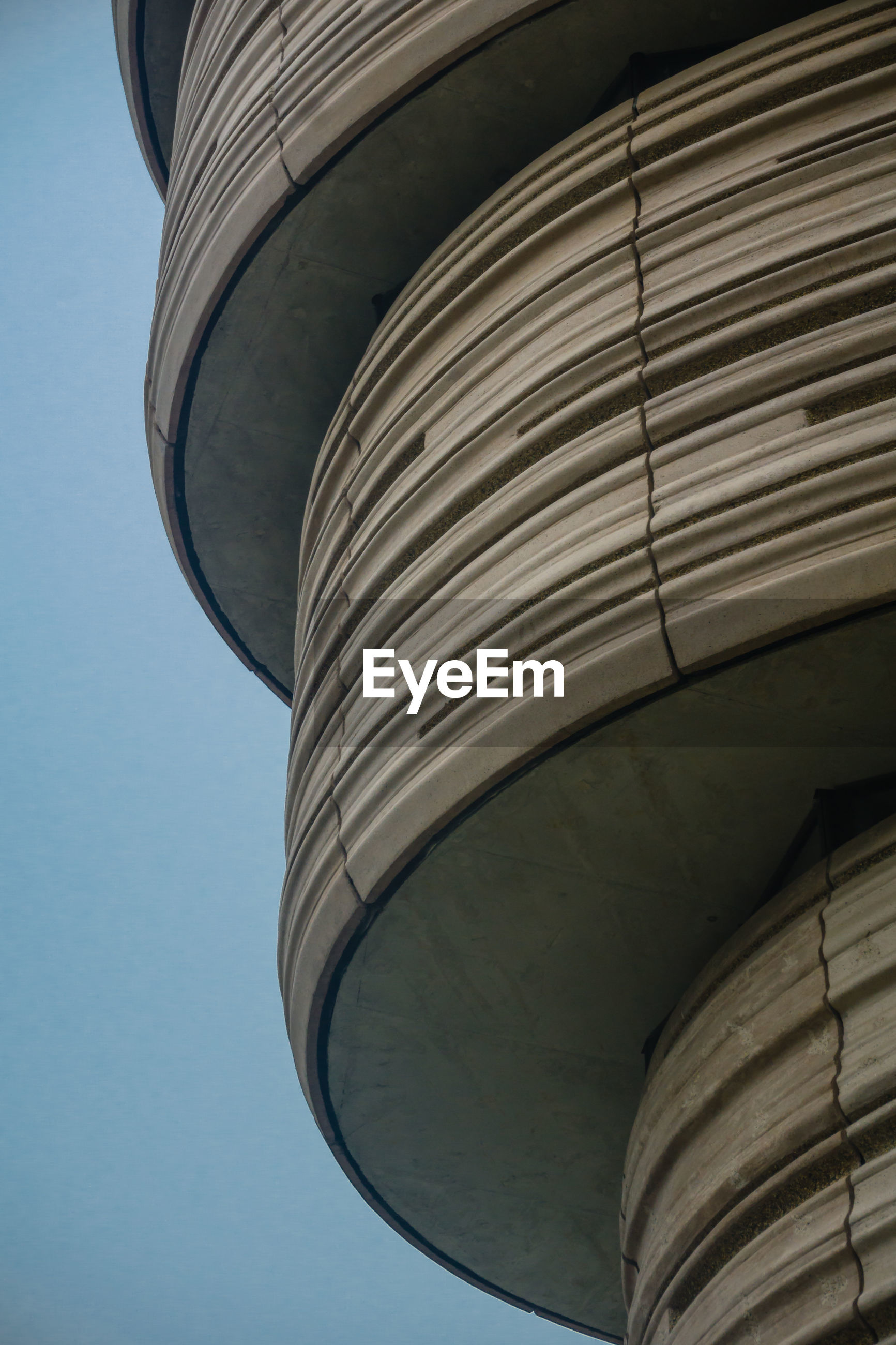 LOW ANGLE VIEW OF WATER TOWER AGAINST SKY SEEN FROM BUILDING