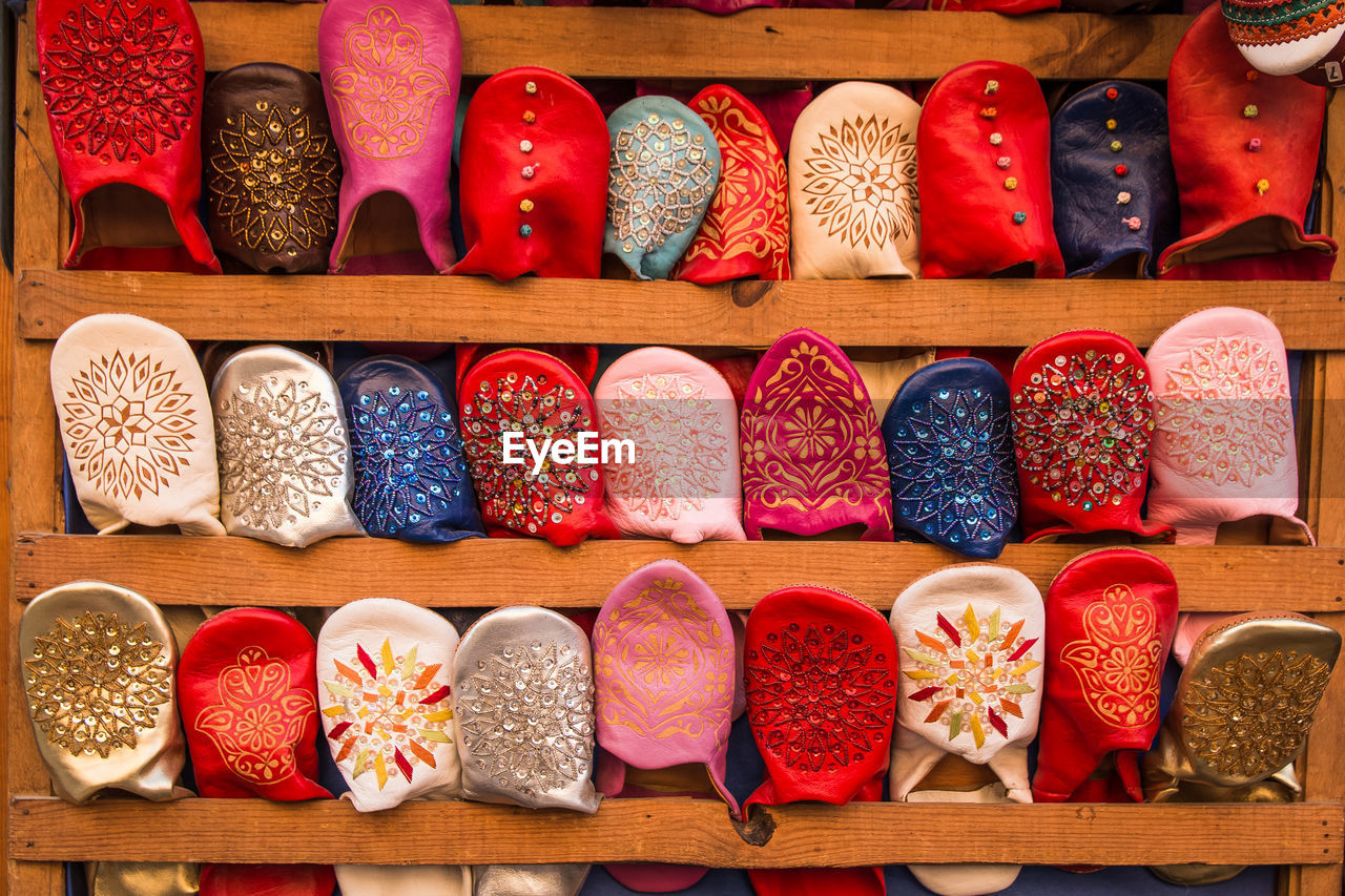 choice, variation, multi colored, wood - material, indoors, shoe, no people, for sale, arrangement, still life, large group of objects, retail, in a row, shelf, close-up, order, side by side, collection, pair, sale, retail display, slipper
