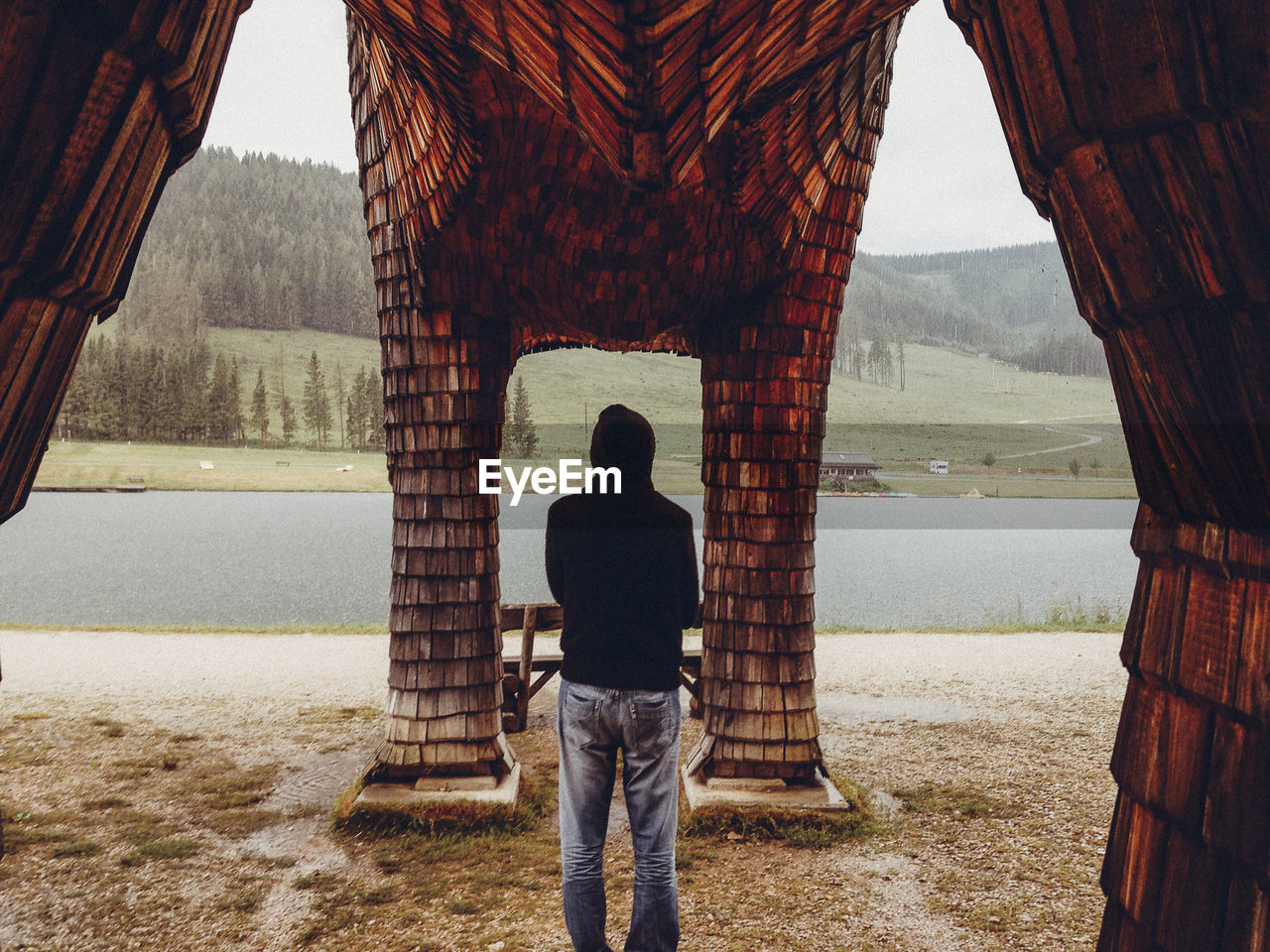 FULL LENGTH OF MAN STANDING AGAINST WALL