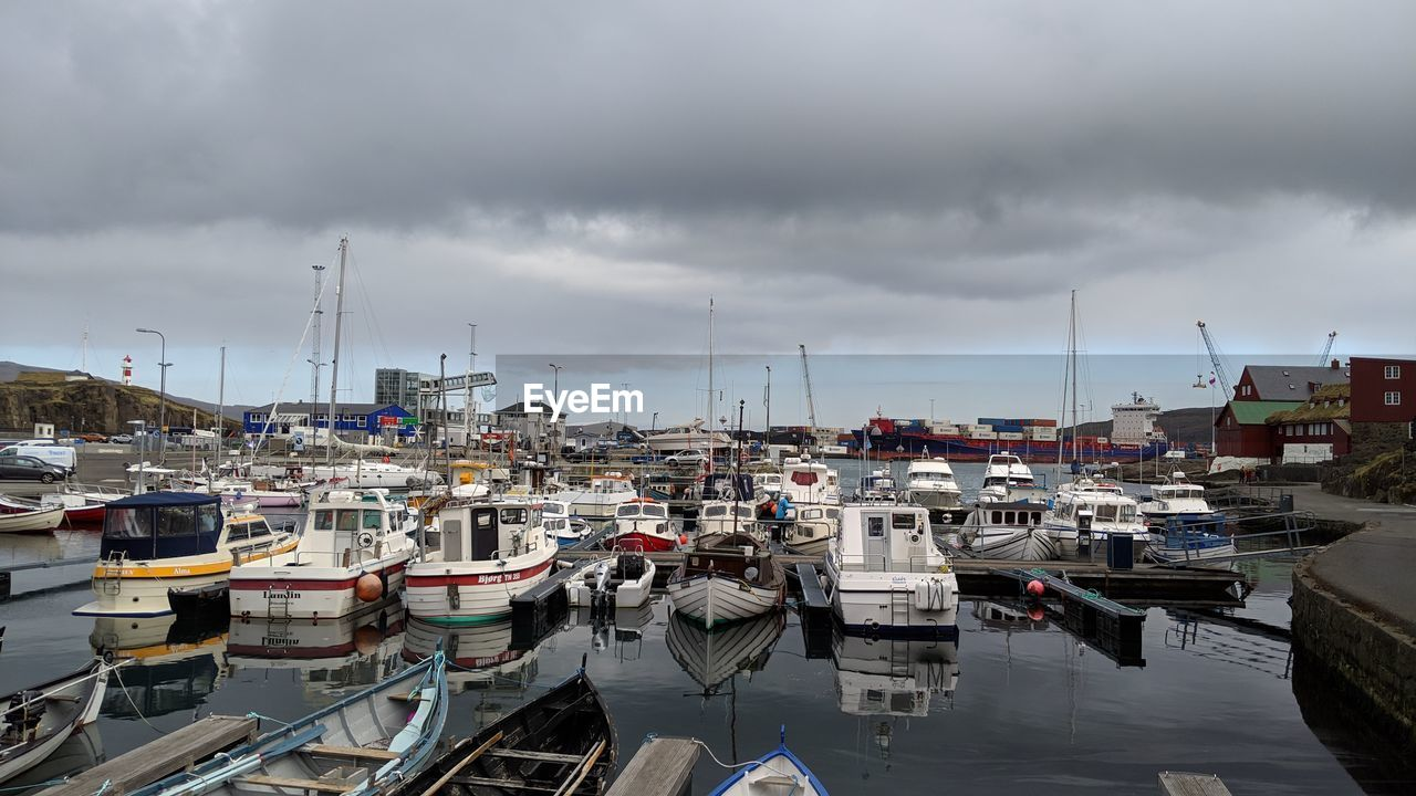 nautical vessel, cloud - sky, mode of transportation, transportation, moored, water, sky, harbor, built structure, architecture, building exterior, no people, day, sailboat, nature, overcast, city, pier, outdoors, yacht, port, marina, fishing boat