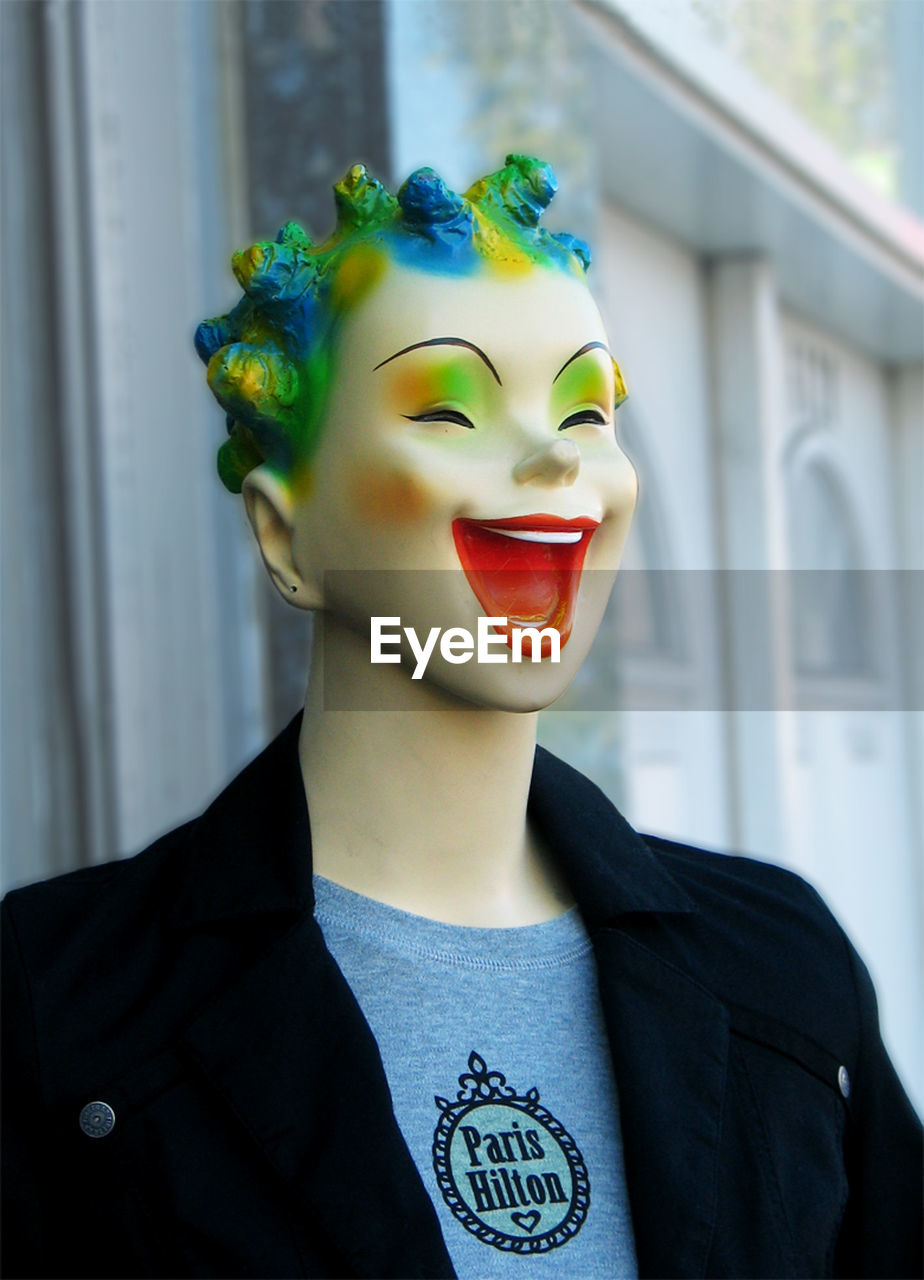one person, front view, focus on foreground, real people, representation, headshot, indoors, lifestyles, art and craft, smiling, portrait, close-up, mask, disguise, day, leisure activity, creativity, young adult, men, human face