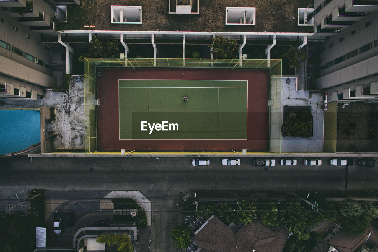 Directly above shot of tennis court amidst buildings in city