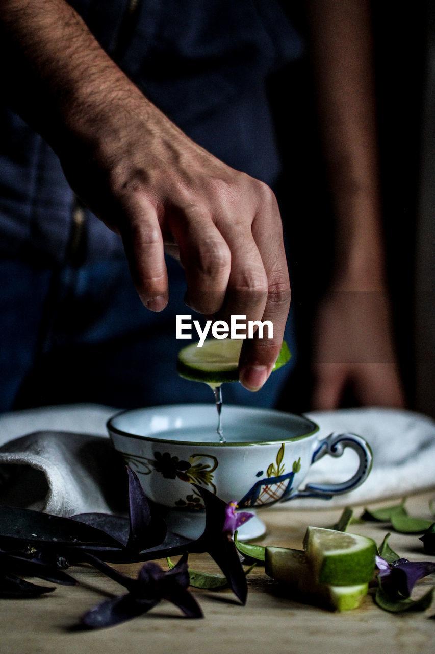 Close-Up Of Man Preparing Tea
