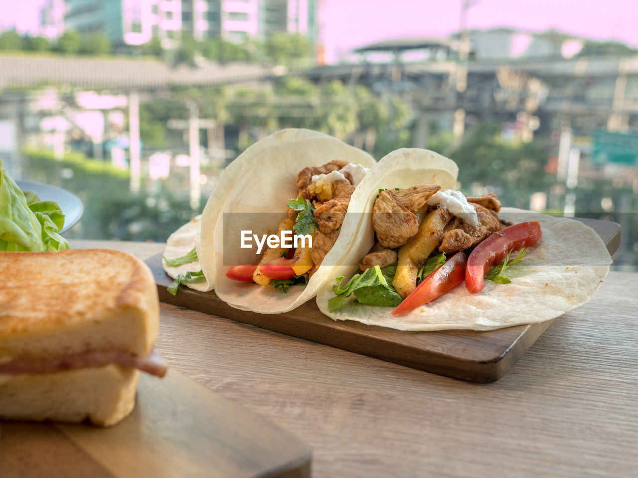 food and drink, food, sandwich, ready-to-eat, freshness, table, vegetable, close-up, bread, fast food, still life, healthy eating, focus on foreground, no people, meat, wood - material, serving size, snack, day, pita bread, temptation
