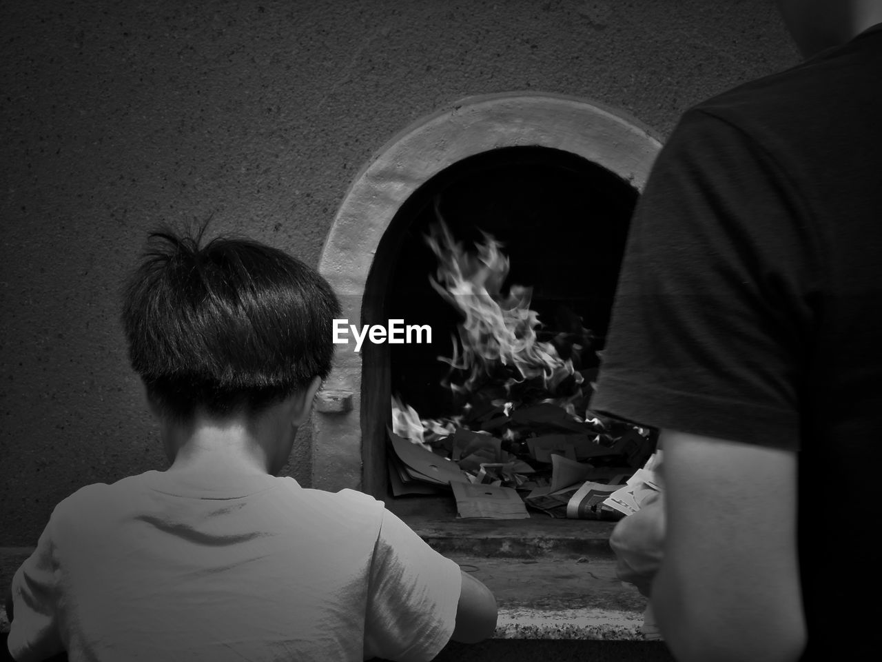 rear view, real people, lifestyles, men, casual clothing, burning, people, fire, fire - natural phenomenon, leisure activity, child, flame, childhood, headshot, heat - temperature, portrait, two people, boys