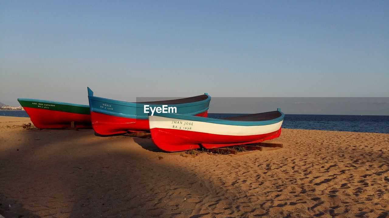 beach, sand, sea, shore, water, horizon over water, nature, tranquil scene, beauty in nature, outdoors, no people, scenics, clear sky, tranquility, nautical vessel, day, sky, moored, vacations