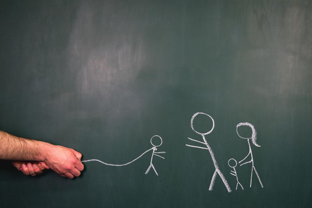 Cropped hands of man drawing on blackboard