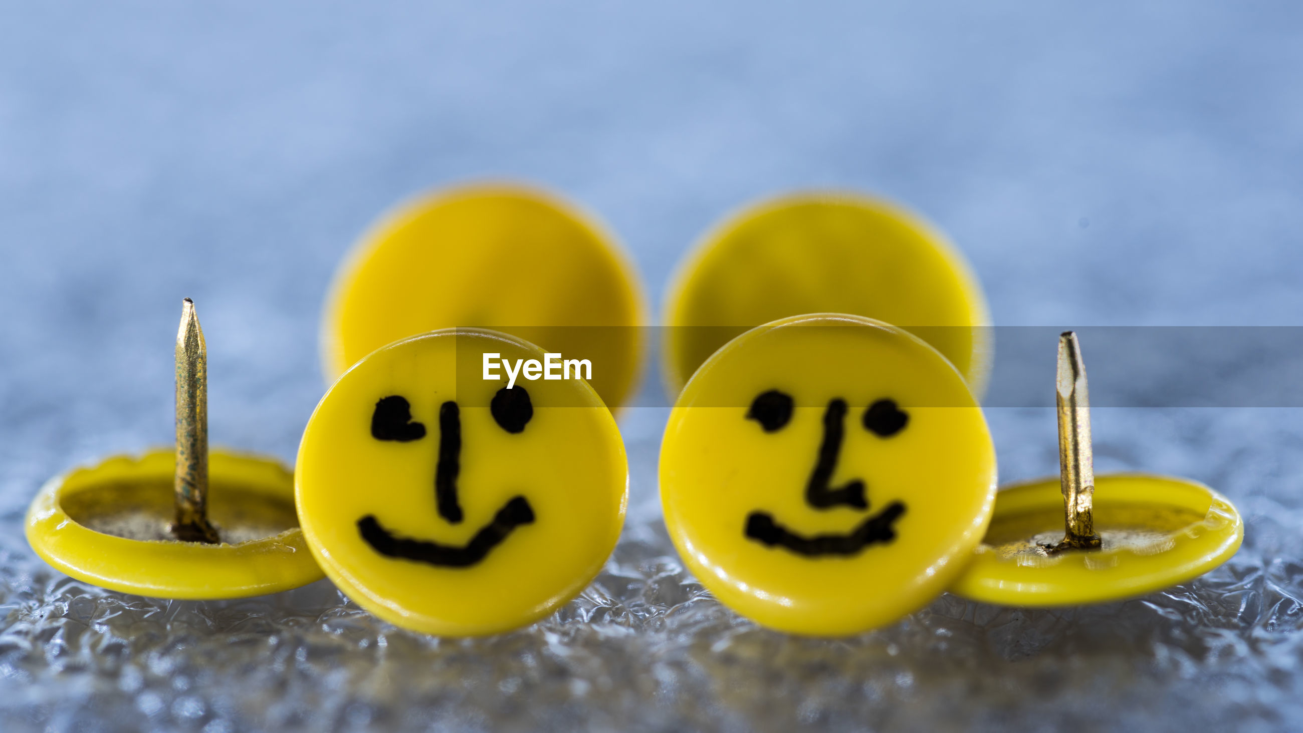 CLOSE UP OF YELLOW AND SMILEY