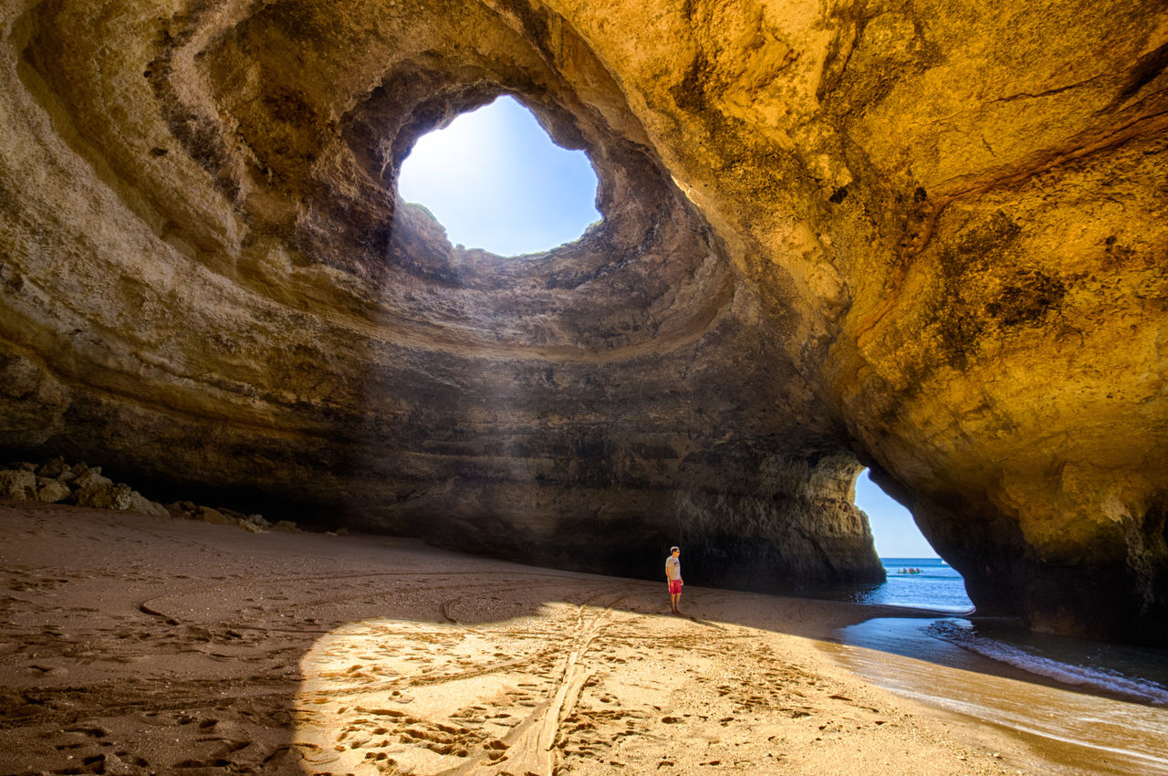 rock, solid, rock - object, rock formation, arch, nature, land, day, scenics - nature, beauty in nature, non-urban scene, physical geography, tranquility, travel, no people, geology, travel destinations, natural arch, architecture, sunlight, outdoors, eroded, arid climate, climate