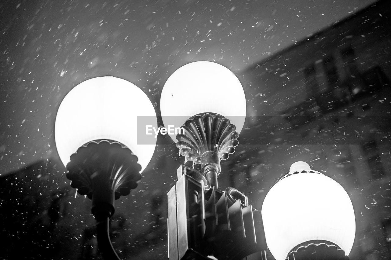 lighting equipment, illuminated, low angle view, outdoors, night, street light, celebration, light bulb, no people, lantern, close-up
