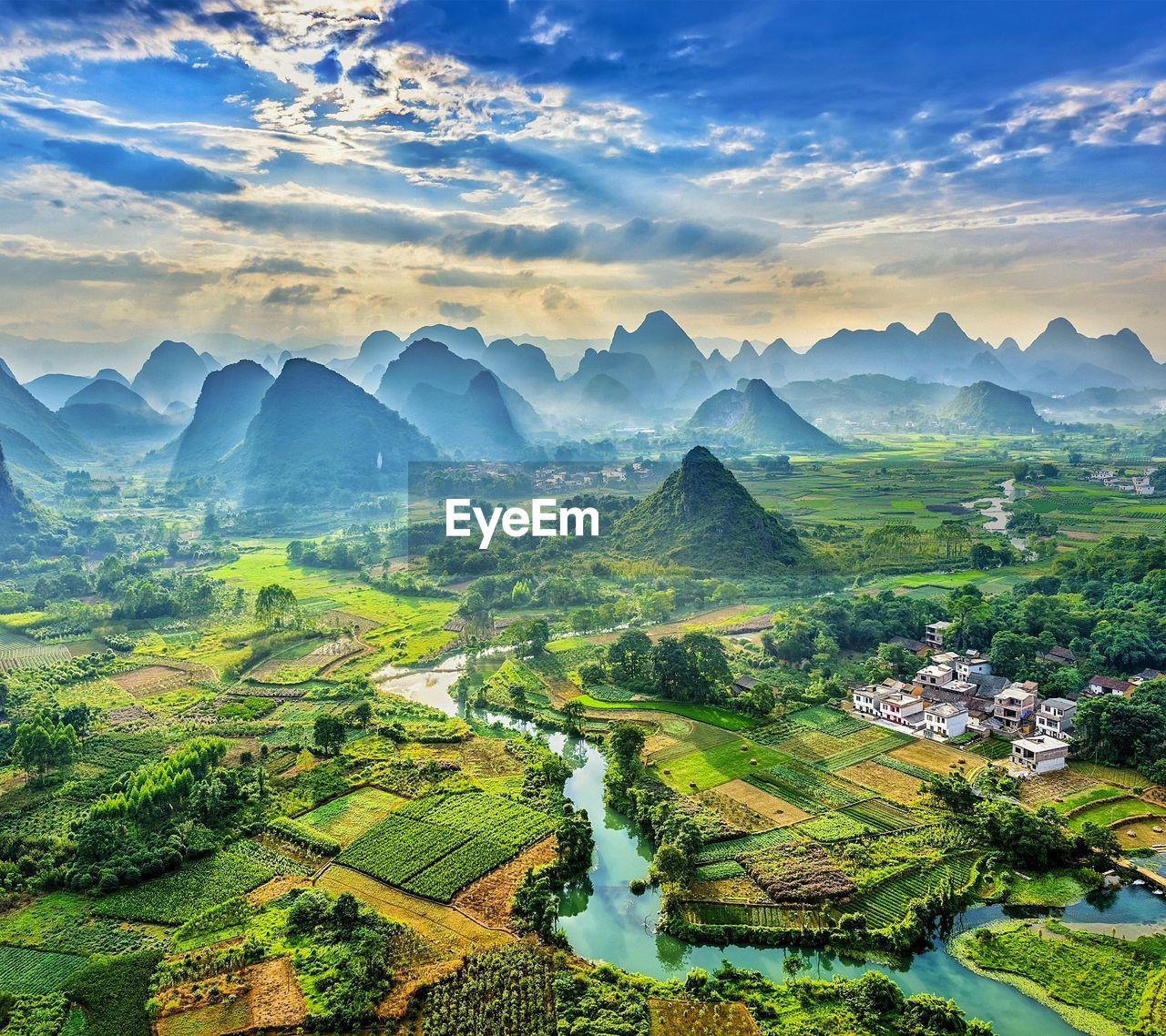 beauty in nature, agriculture, tranquil scene, scenics, nature, landscape, sky, farm, tranquility, field, cultivated land, rural scene, cloud - sky, idyllic, mountain, no people, high angle view, outdoors, rice paddy, patchwork landscape, tree, terraced field, water, day