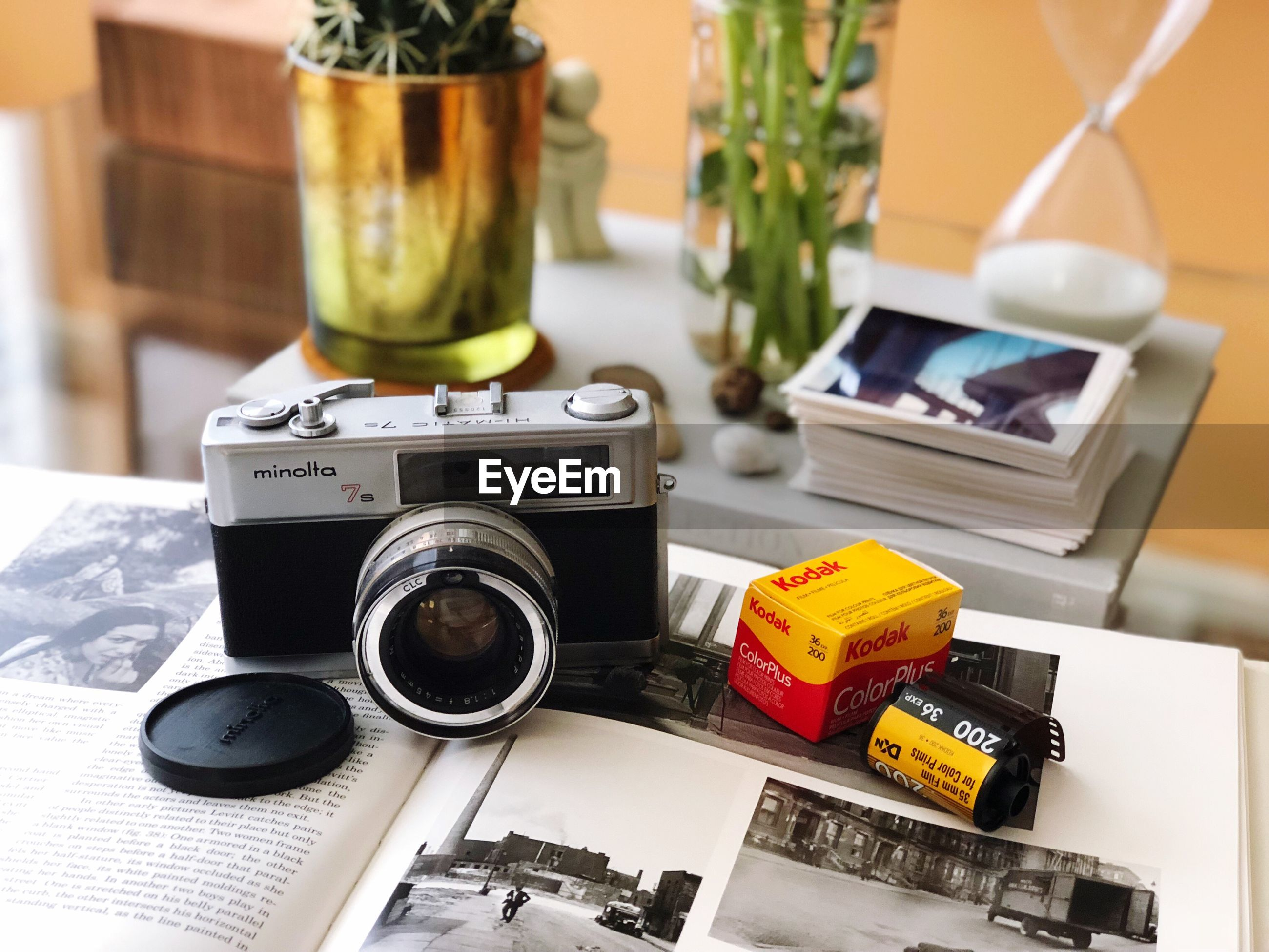 CLOSE-UP OF CAMERA AND BOOK ON TABLE