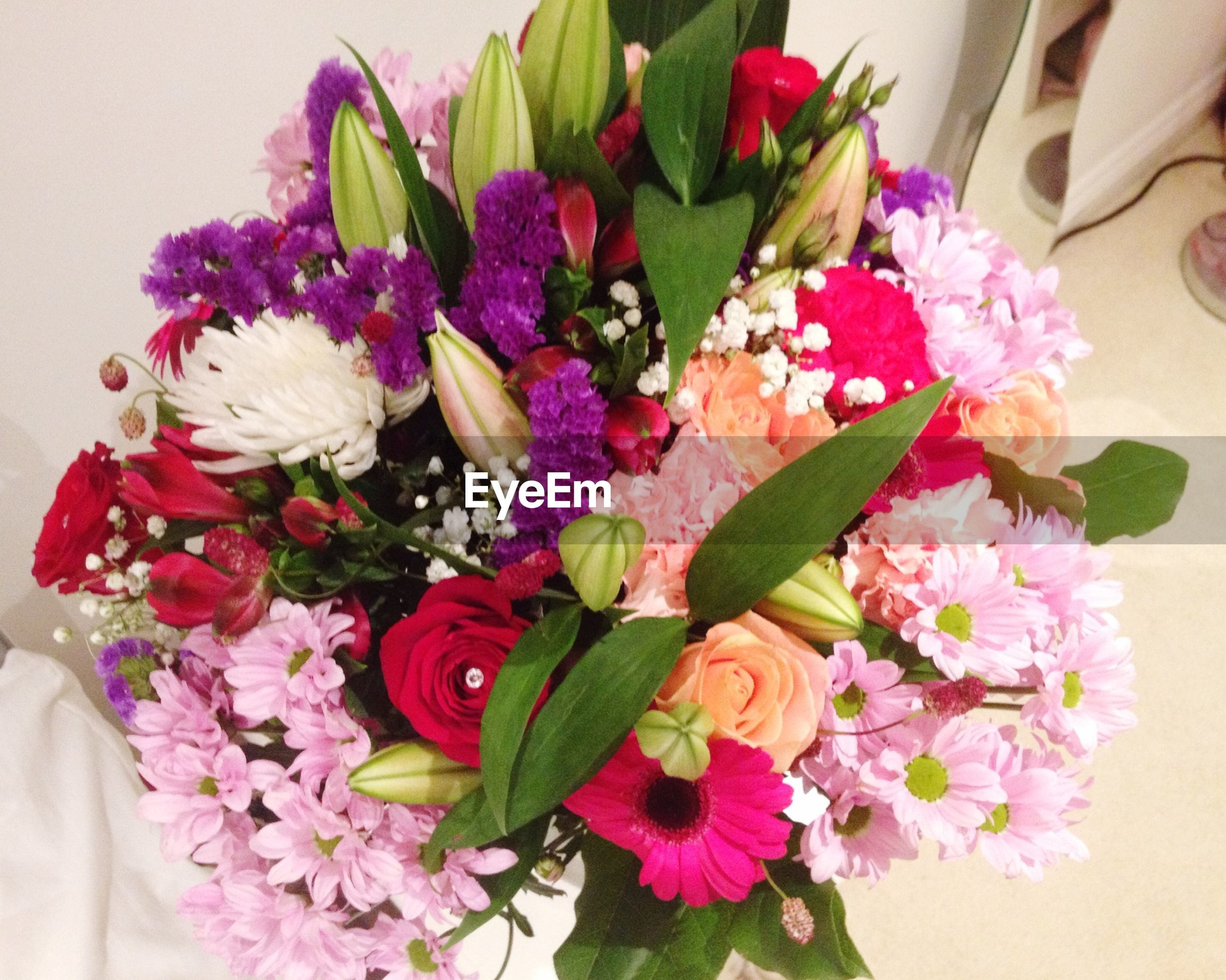 flower, freshness, petal, fragility, indoors, flower head, bouquet, bunch of flowers, beauty in nature, vase, growth, flower arrangement, leaf, close-up, nature, pink color, plant, decoration, multi colored, high angle view