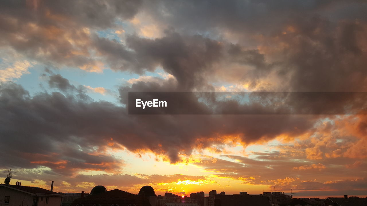 sunset, cloud - sky, sky, dramatic sky, beauty in nature, built structure, atmospheric mood, nature, scenics, building exterior, architecture, no people, silhouette, outdoors, tranquil scene, storm cloud, tranquility, low angle view, city, day