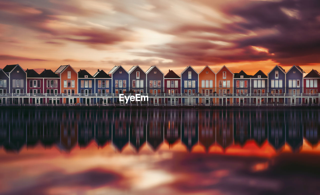 sky, cloud - sky, water, sunset, built structure, architecture, nature, no people, orange color, building exterior, reflection, beauty in nature, building, side by side, dusk, scenics - nature, outdoors, sea, tranquil scene