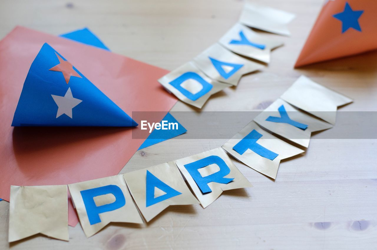 High angle view of party sign on table