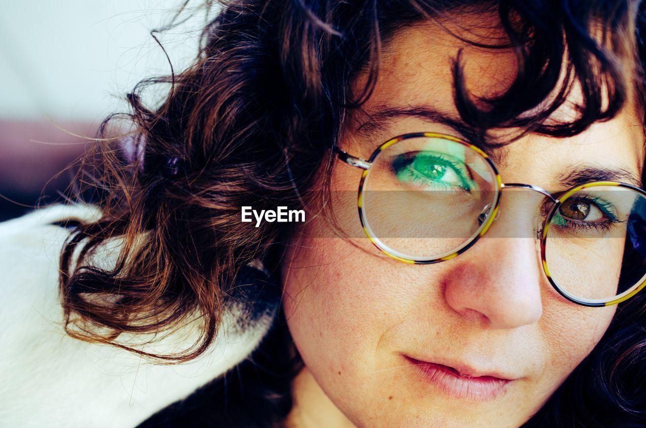 Close-up portrait of woman wearing eyeglasses